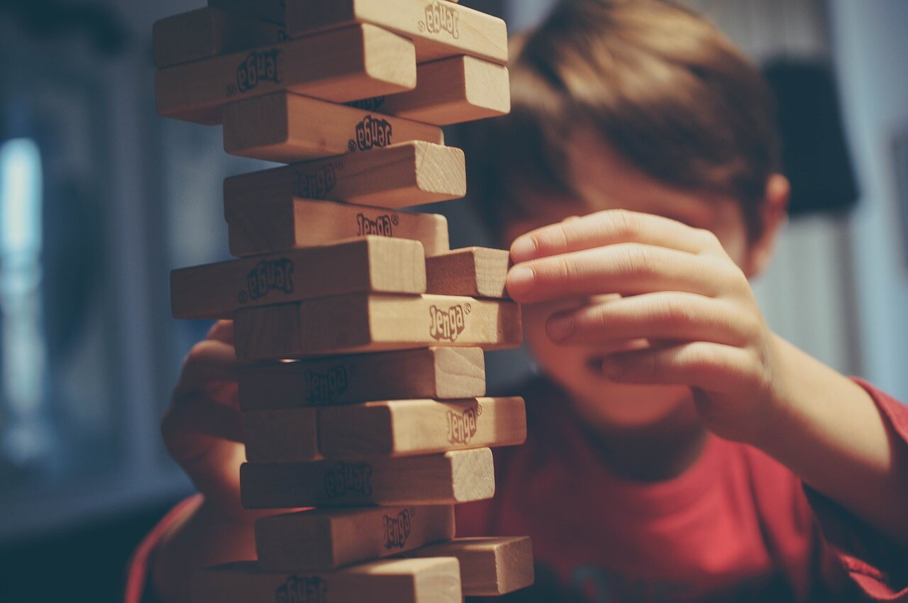 Investing in the stock market is like a Jenga game